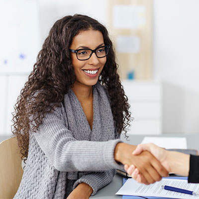 Woman shaking hand of employer